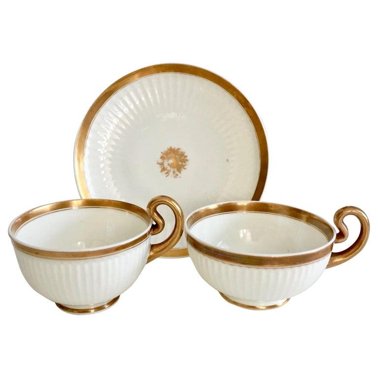 Swansea Porcelain Tea Set, Tea & Breakfast Cup White and Gilt, Regency ca 1820 For Sale