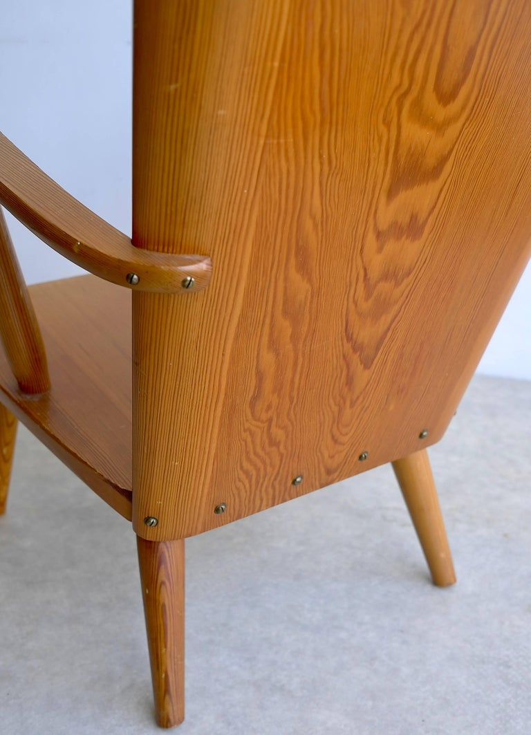 Rare Swedish armchair in pinewood designed by Goran Malmvall, Manufactured by Svensk Fur, circa 1940. The chair is completely made of pinewood. Features a curved back, seat, and armrest Marked: Svensk Fur.
