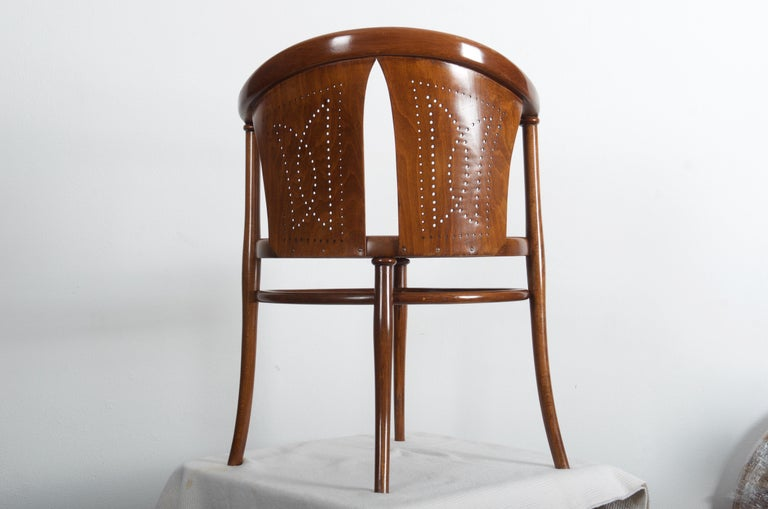 Beech bentwood nut brown stained with a perforated seat and backrest made by Thonet, circa 1900s.