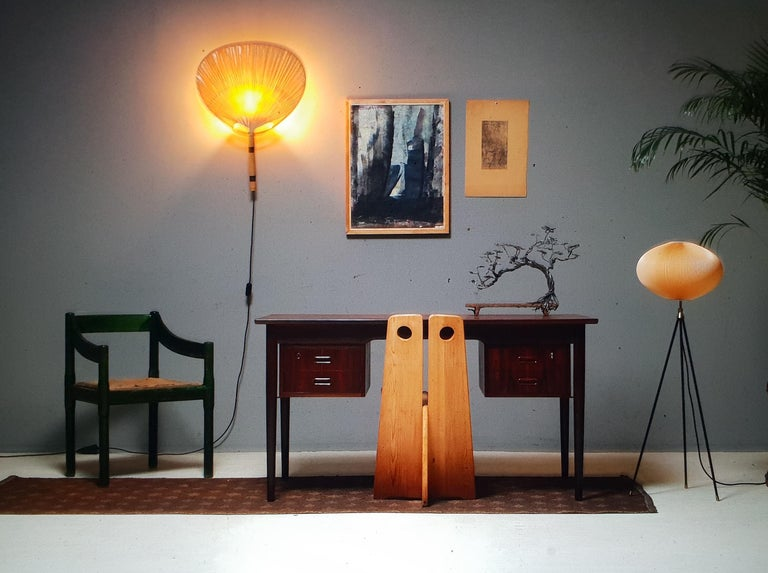 A rare tripod floor lamp produced by the German lighting company Aro Leuchte. This floor lamp is from the late 1950s-early 1960s. The tripod is made out of black lacquered steel and does have beautiful brass elements. The shade is made from hand