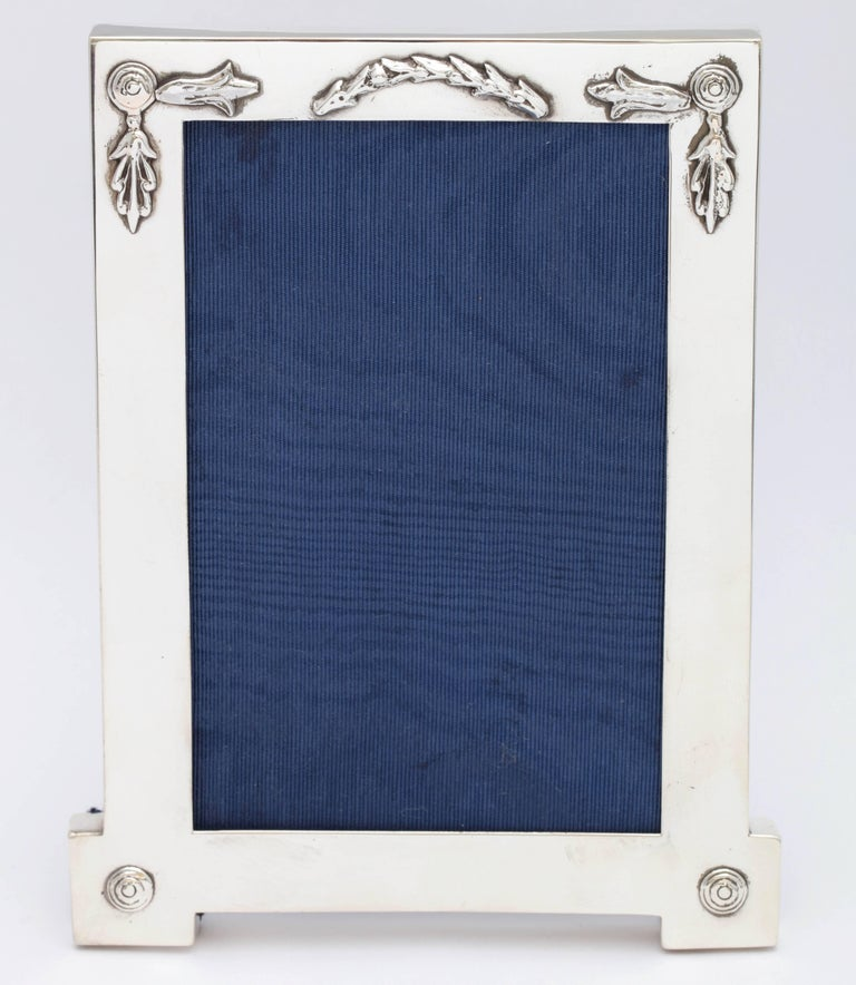 Rare, unusual, Edwardian, sterling silver, footed picture frame, London, 1909. Measures 6 1/2 inches high x 5 inches wide at widest point x 4 inches deep when easel is in open position. Holds a photo that measures 4 inches x 6 inches; window will