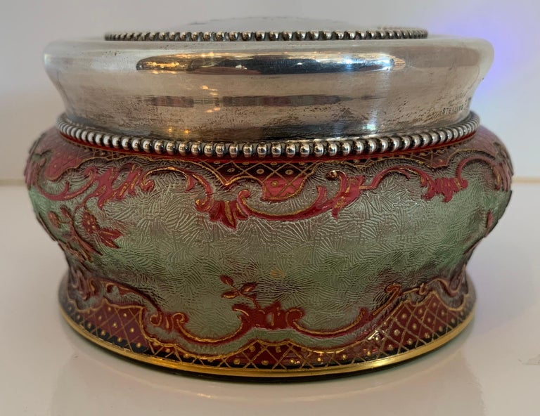 A rare Val St Lambert cranberry and green acid etched cameo crystal with gold over tones powder jar with sterling top.