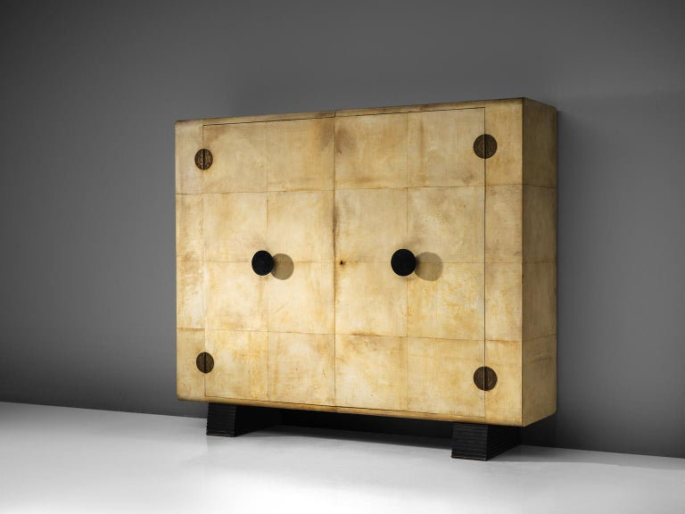 Valzania, armoire made in parchment, brass, mahogany and ebonized wood, Italy, circa 1935.  This grand wardrobe made with parchment, is a unique piece, both in its design and in the use of material. The piece in this exquisite condition and size
