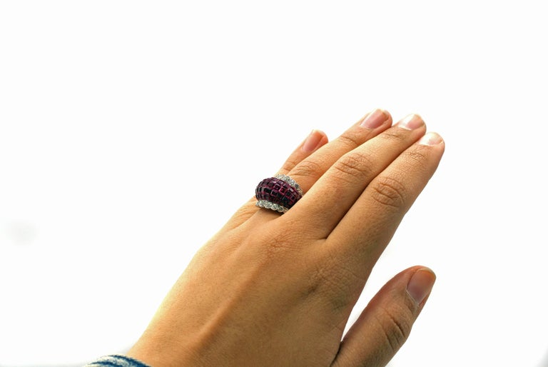 Extremely rare platinum diamond and ruby Mystery Set Ring by Van Cleef and Arpels. This ring is set with 75 impeccably matched Burmese rubies, the setting invisible to the eye from the top of the ring. An even flow of gorgeous red around the finger