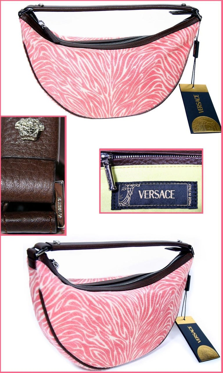 BRAND NEW VERSACE BAG  With its luxurious textures and chic silhouette, this gorgeous bag exudes contemporary glamour. In zebra-printed calf hair, finished with brown leather and silver metal hardware.  Zebra-printed calf hair with brown leather