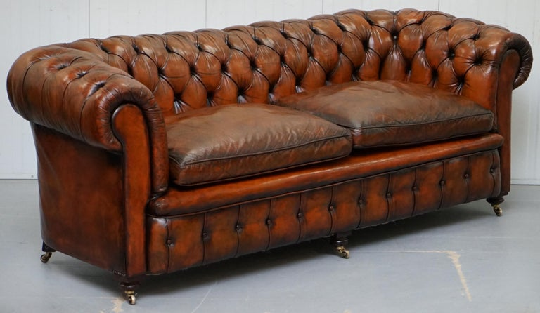 We are delighted to offer for sale this very rare fully restored circa 1880 hand dyed Whiskey brown leather Chesterfield sofa with original horse hair padding, coil sprung all over and feather filled cushions 