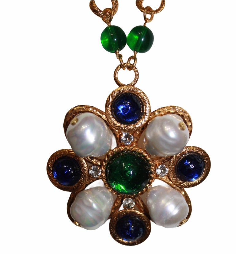 Vintage necklace circa 1990. Pate de verre process by Gripoix in blue and green. Handmade glass pearls. Chain is 18-carat gilded brass. Pendant is 2.75