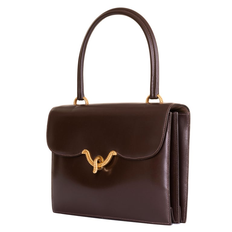 In excellent condition throughout, the 'Sac Cordeliere' is a rare vintage Hermes Handbag. This exquisite example is finished in Chocolate brown Box leather with 18ct. gold-plated hardware. Very lightly used, the bag is from a private collection in