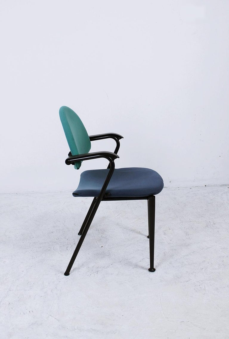 Rare designer chairs of the brand Vitra Bellini Summa in unusual  color combination blue / green. The Italian designer Mario Bellini creates several office chairs for the Vitra brand, such as: