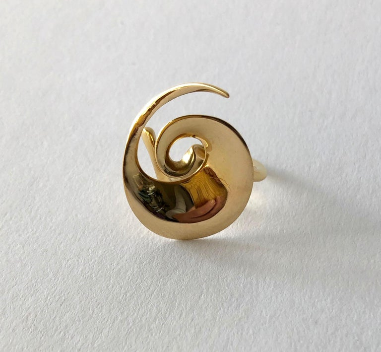 A rare, 18 karat gold spiral ring by Vivianna Torun Bülow-Hübe for Georg Jensen, circa 1950's. Ring is a finger size 6 to 6.5 due to its unusual design.  Signed Torun, George Jensen, 750, Denmark.  In very good vintage condition. 7.5 grams.