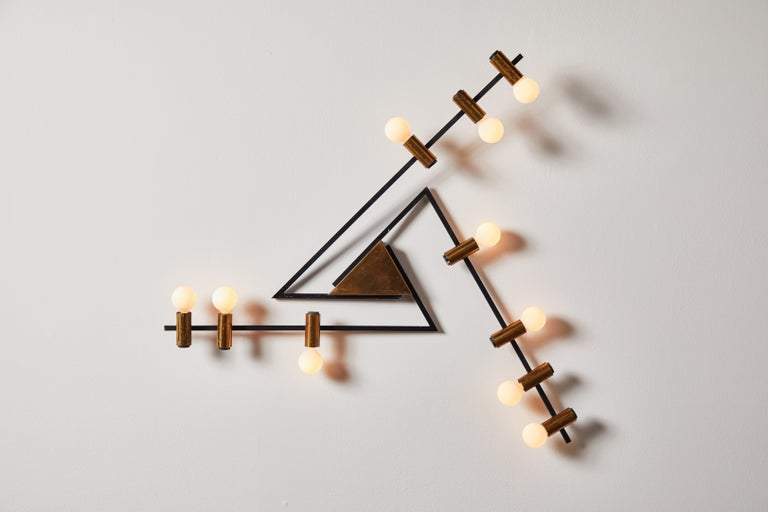 Rare wall light by Giampiero Aloi for Stilnovo. Designed and manufactured in Italy, circa 1950s. Brass, enameled metal. Rewired for U.S. junction boxes. Retains original manufacturers label. Takes ten E27 European candelabra bulbs, 25w maximum each.