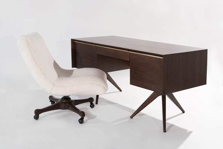 Impressive and rare walnut desk designed by Vladimir Kagan for Grosfeld House, NY, circa 1950s. Walnut case design features ebony stripes, caned back, and brass hardware.   Completely restored to back its original integrity, drawers slide