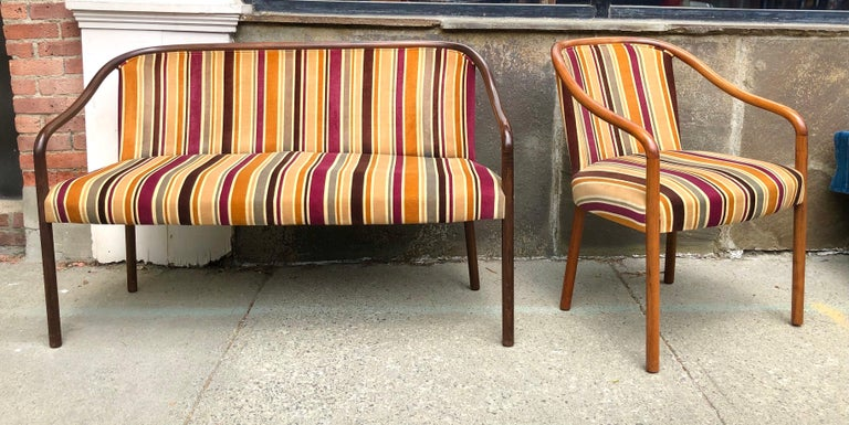 Bent ash frame with remarkably clean original mod striped cotton velvet upholstery. The chair frame is in a lighter stain wood but otherwise matches. Chair is 23