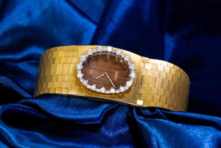 Rare Wide 1970s Omega Diamond Set Wood Dial 18 Karat Yellow Gold Bracelet Watch For Sale 9