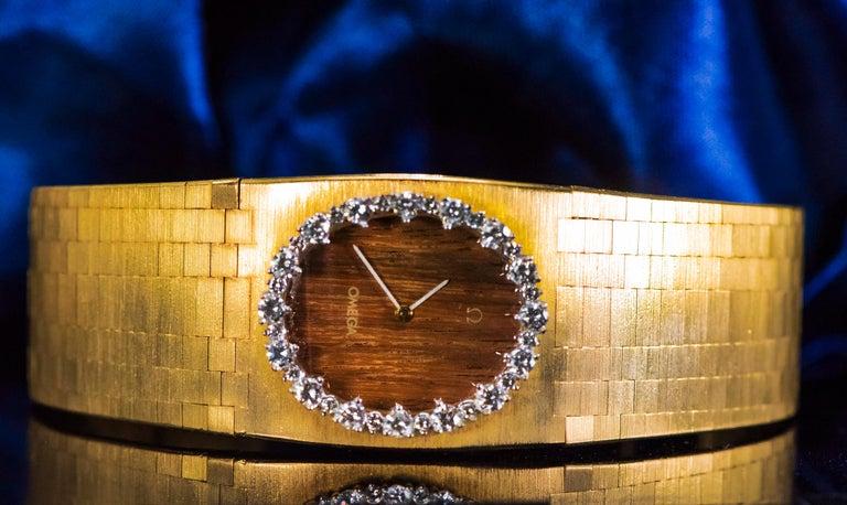 Rare Wide 1970s Omega Diamond Set Wood Dial 18 Karat Yellow Gold Bracelet Watch For Sale 11
