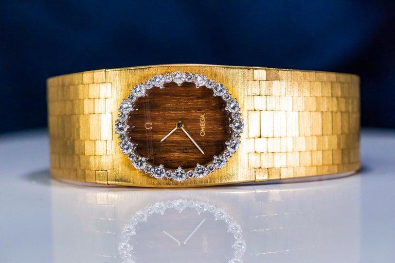 Rare Wide 1970s Omega Diamond Set Wood Dial 18 Karat Yellow Gold Bracelet Watch For Sale 3