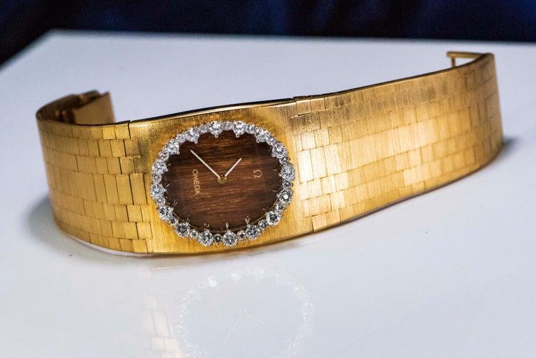 Rare Wide 1970s Omega Diamond Set Wood Dial 18 Karat Yellow Gold Bracelet Watch For Sale 4