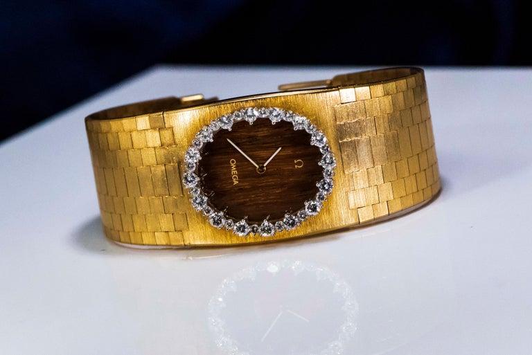Rare Wide 1970s Omega Diamond Set Wood Dial 18 Karat Yellow Gold Bracelet Watch For Sale 5