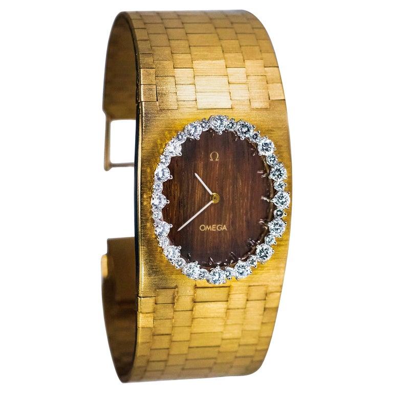 Rare Wide 1970s Omega Diamond Set Wood Dial 18 Karat Yellow Gold Bracelet Watch For Sale