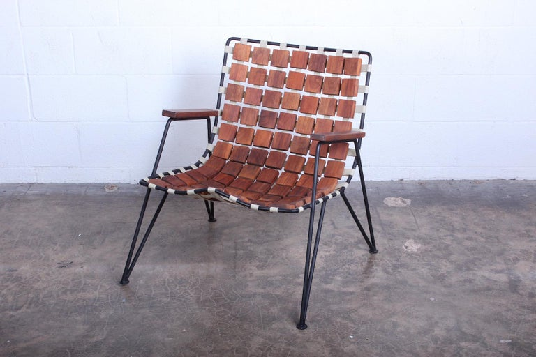 A rare wood block and iron lounge chair by Maxwell Yellen, Yellen Interiors, New York, 1954.