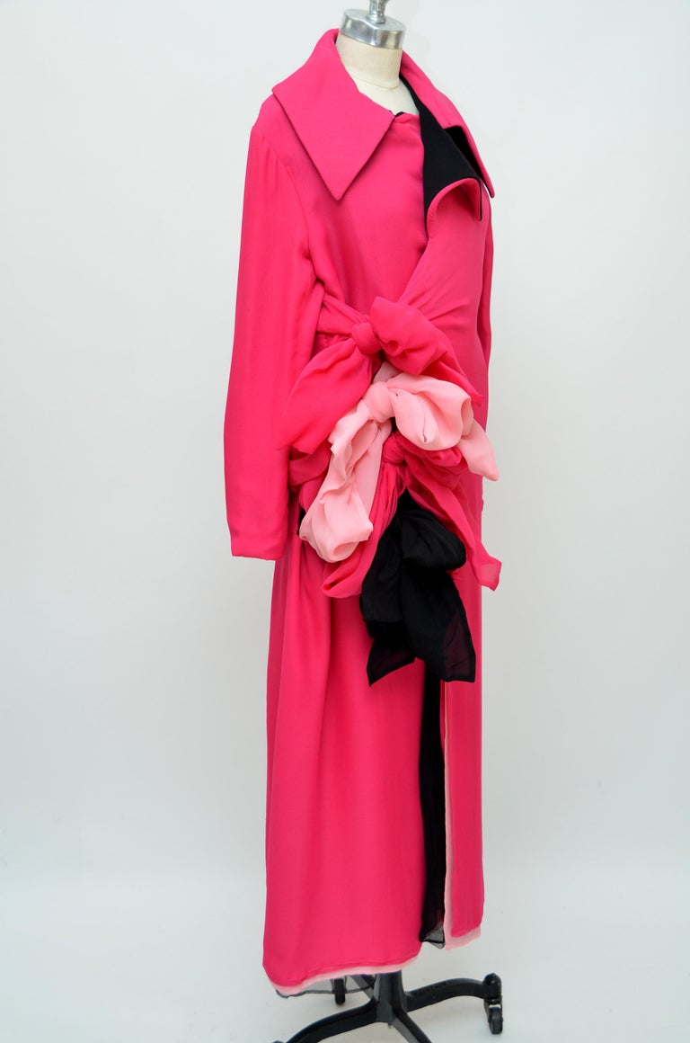 Yohji Yamamoto runway 2005 pink  fuchsia silk coat dress . Made of multiple layers of silk tied together with sash tie  bow's  in the front. Size 3. Condition:looks new, possibly never worn.Fabric looks new. Made in japan.  FINAL SALE.