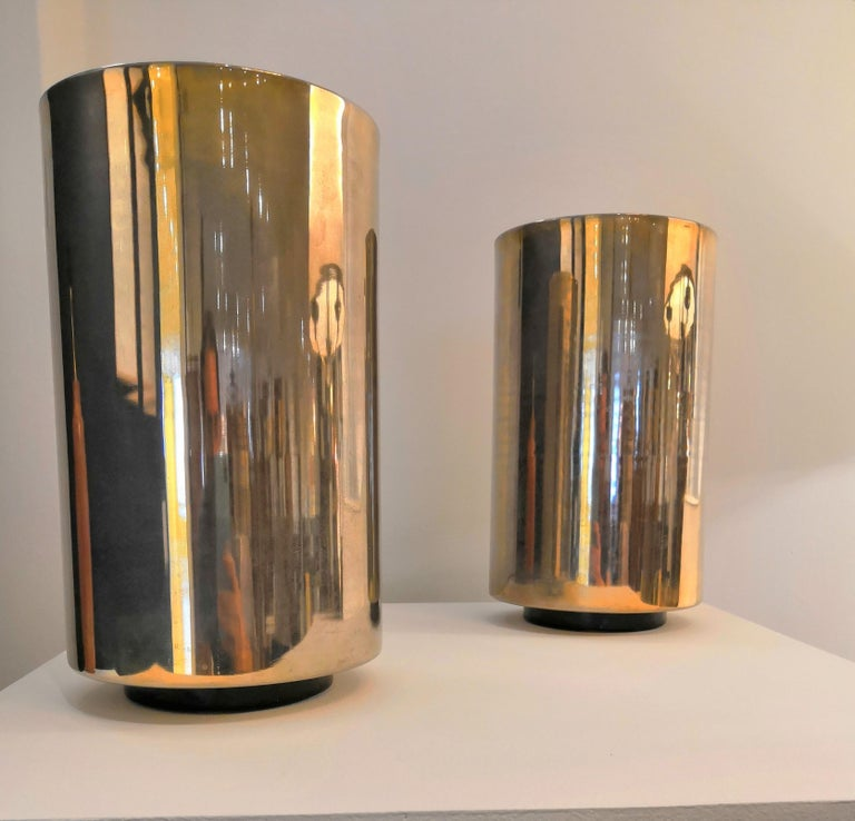 Pair of nickel-plated uplighters by Roger Nathan
