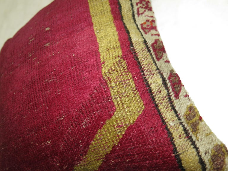 Pillow made from a border of a glamorous antique Turkish Oushak rug.
