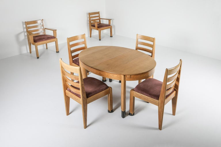 Oak dining set, Dutch Art Deco era, Hague school, 1928  Oval dining table in oak, on juxtaposed oval legs, Dutch, 1920s Rationalist dining chairs, set of four, with sculptural front legs. Rationalist armchairs, a pair, with sculptural arms and