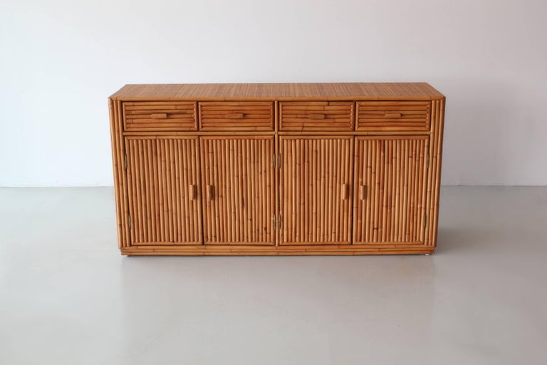 Rattan cabinet wonderfully constructed with four drawers and open shelving.