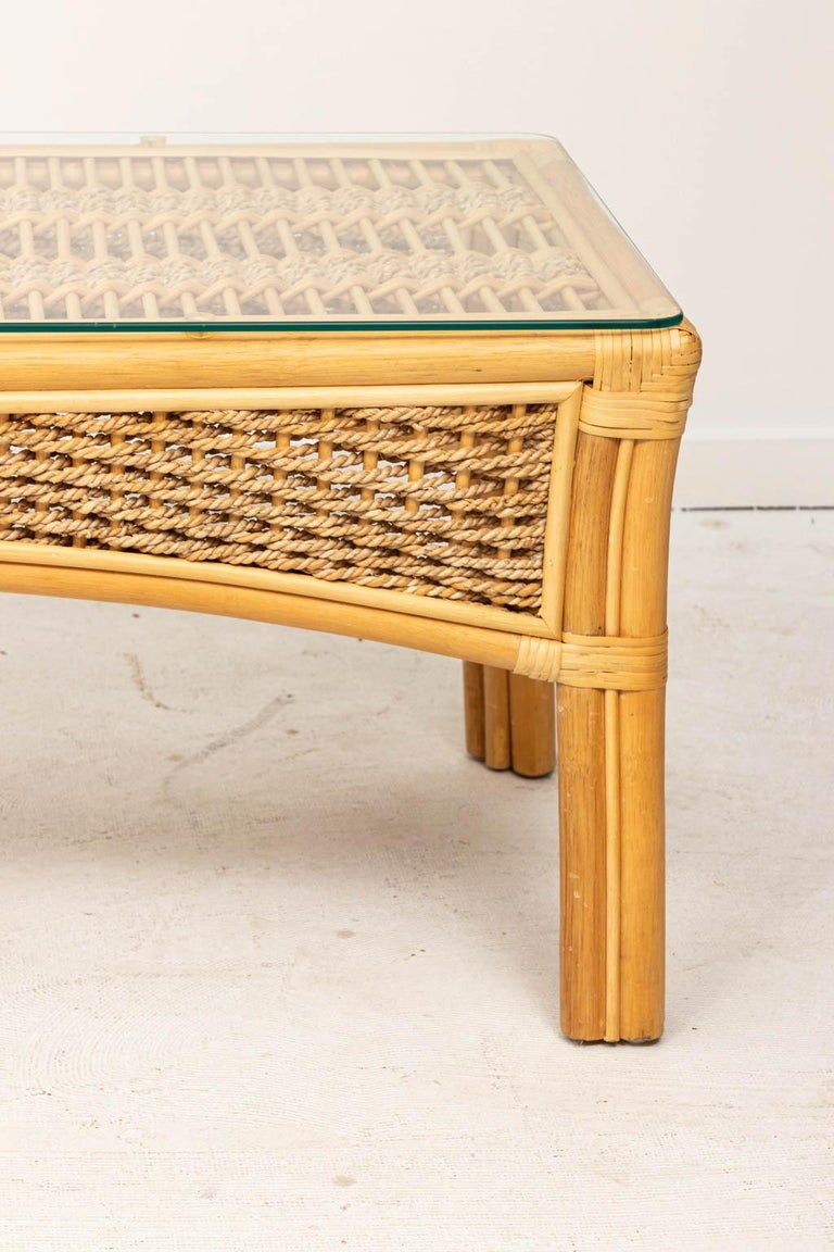 Bamboo and rope coffee table with glass top. Great for the beach house. Few scratches to glass top