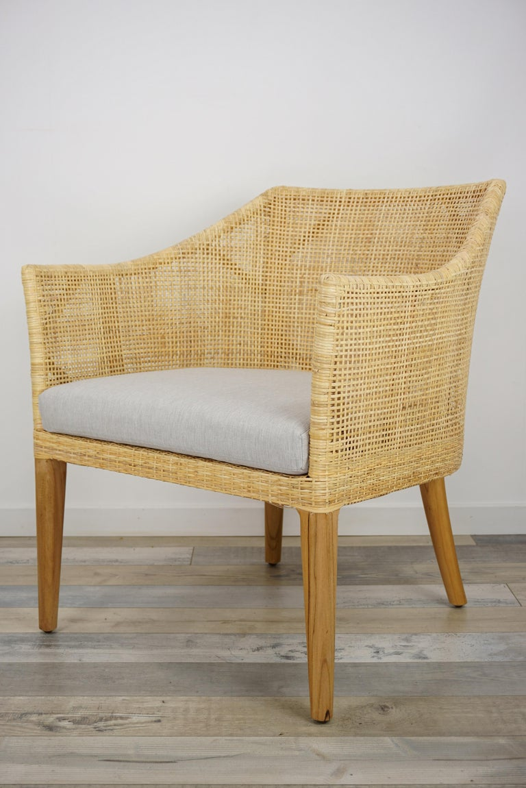 Elegant rattan sofa with wooden structure combining quality, robustness and class. Comfortable and ergonomic, aerial and poetic. The armrests height is 60cm and the seat height with cushion is 42cm (35cm without) All the cushions are include. In