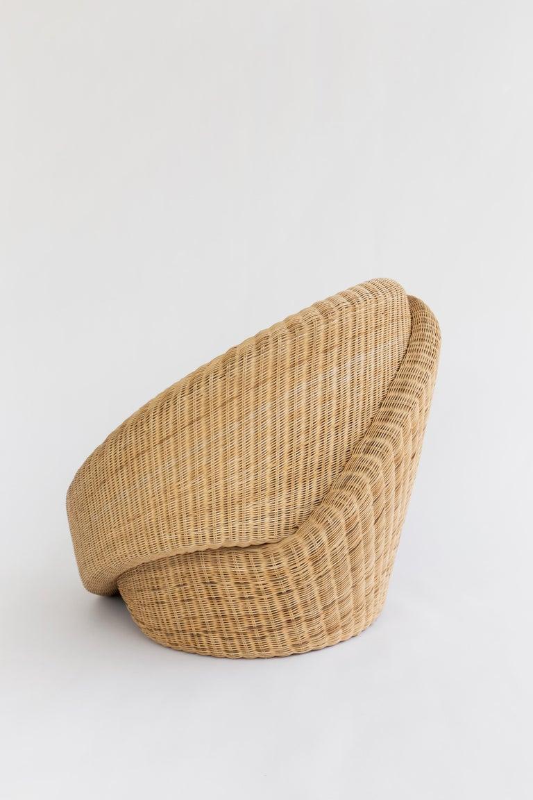 Minimalist Rattan Indoor-Outdoor Armchair and Footrest/Ottoman, Cushions in Sunbrella  For Sale