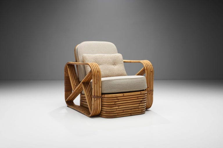 This highly distinctive bamboo rattan chair is in the style of the Austrian Art Deco and mid-century furniture designer and architect, Paul T. Frankl.  Without a doubt, the solid bamboo frame is the stand-out characteristic of this lounge chair. For