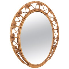 Rattan Ovoid Mirror with Filigree Peacock Frame, Spain, 1960s