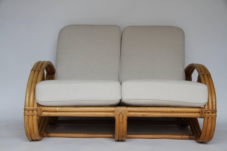 Rattan Pretzel Loveseat in the Style of Paul Frankl In Good Condition For Sale In Houston, TX