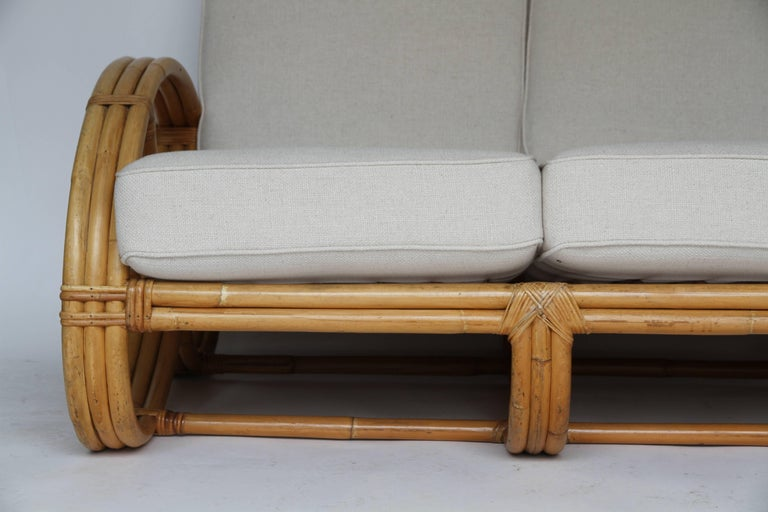 20th Century Rattan Pretzel Loveseat in the Style of Paul Frankl For Sale