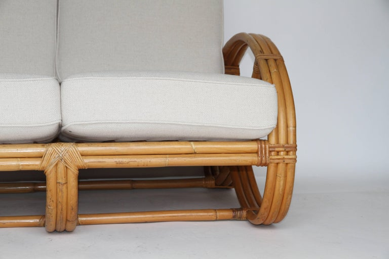 Upholstery Rattan Pretzel Loveseat in the Style of Paul Frankl For Sale