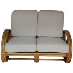 Rattan Pretzel Loveseat in the Style of Paul Frankl