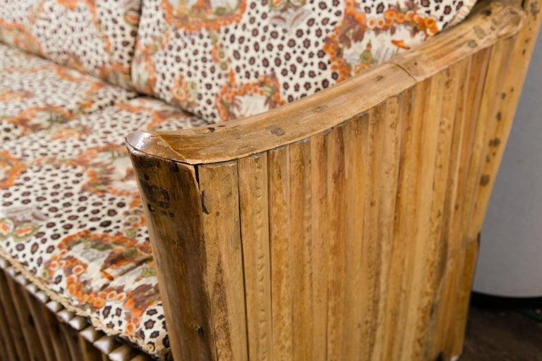 1920s Adirondack stylish rattan loveseat. Cushions fabricated in a Schumacher fabric.