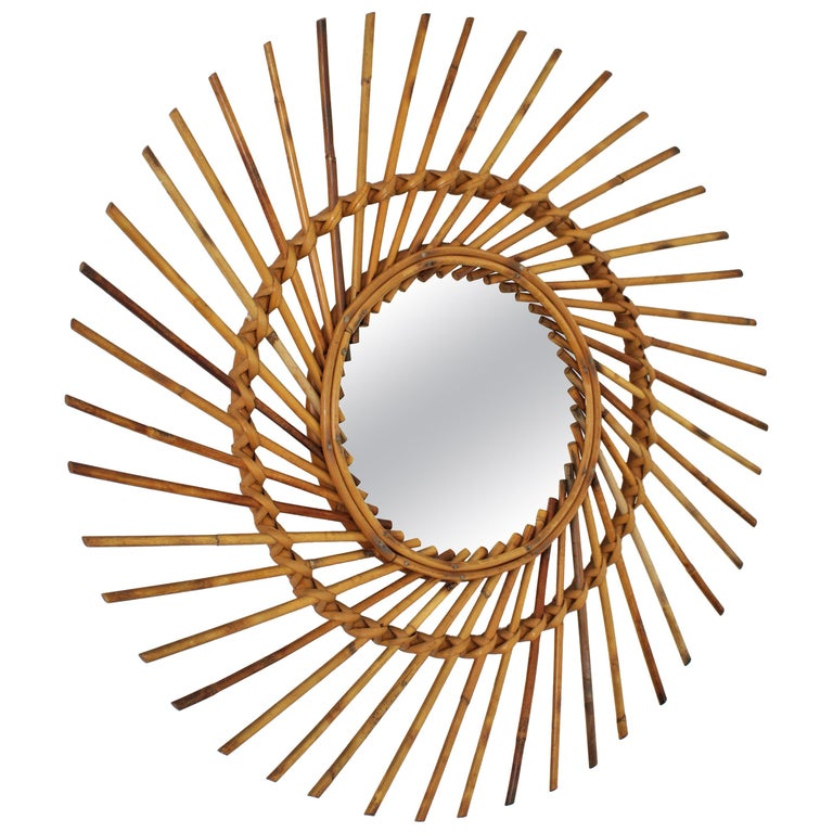 Midcentury sunburst mirror handcrafted in rattan. Spain, 1960s. This handcrafted sunburst mirror has a design with pinwheel shape. It has all the taste of the Mediterrean coast style and it will be a nice addition to any beach house or countryside
