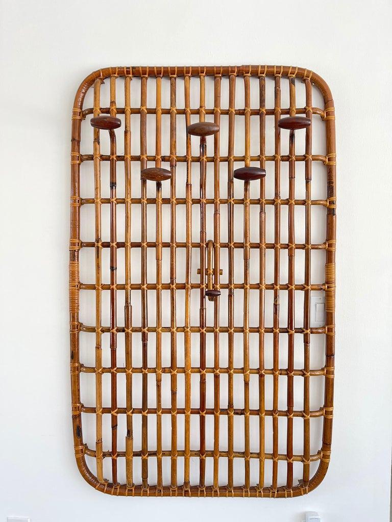 Italian bamboo coatrack with convex shape - 5 wood hooks and floating rattan hook.  Wall mounted.