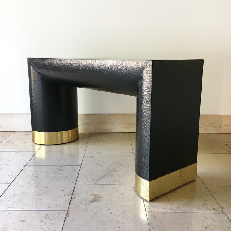 Ebonized rattan wrapped Karl Springer style console table with chuncky half moon legs and tarnished brass detail, 1970s.