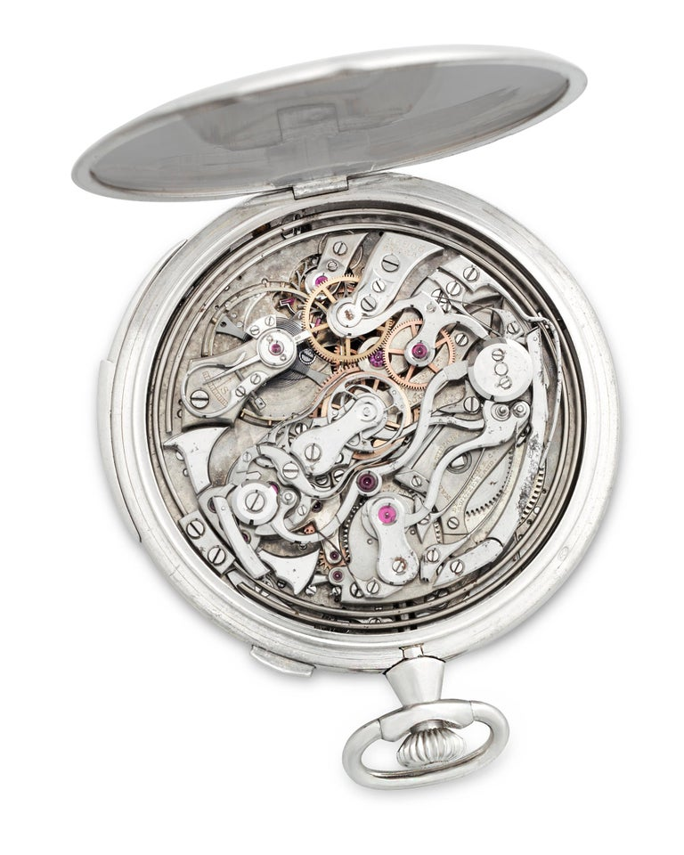 A study in classic design, this minute repeater pocket watch was crafted by the celebrated Touchon & Co. for Tiffany & Co. Encased in platinum, the open face timepiece tells the time on a brushed silver dial with both Roman and Arabic numerals and