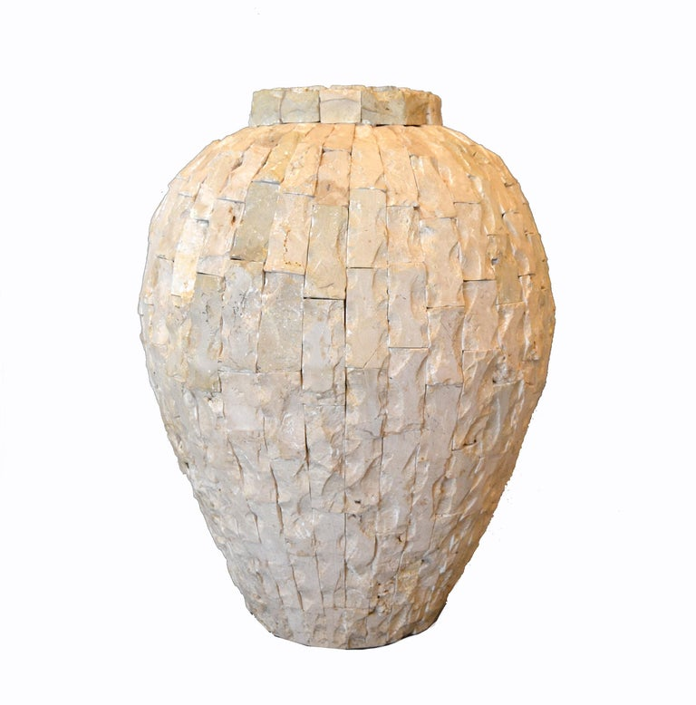 Heavy raw tessellated fossil stone over clay floor vase. The stone pieces are not polished and have great patterns as well as sea shells. Will look great in a sunroom.
