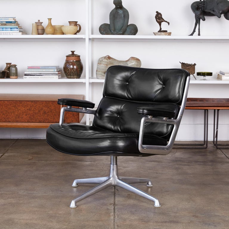 A legendary office design by Ray and Charles Eames for the three modernist lobbies of the new Time Life Building in Manhattan, the Time Life lobby chair has a polished aluminum frame and segmented, tufted cushions in leather upholstery. Leather