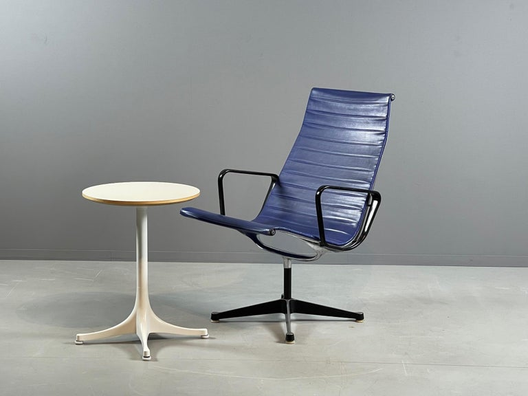 The two star designers meet at the end of the 30s and work from 1945 to the 70s in their joint studio on their legendary pieces of furniture.  This offer is about a well preserved lounge chair EA 116 in original blue vinyl from the Herman Miller