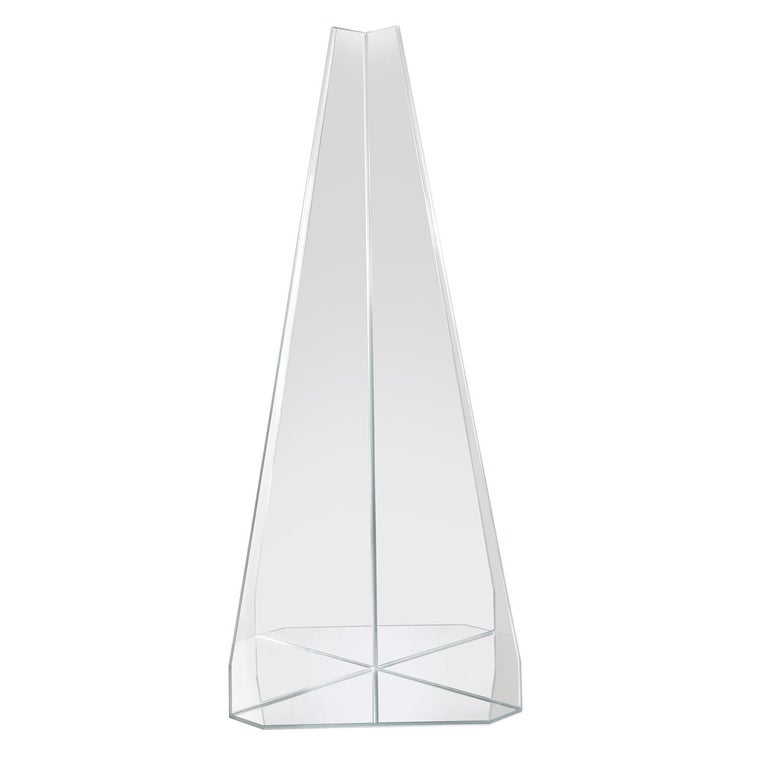 Designed by Marco Brunori, this wall mirror is a superb accent in a modern or eclectic interior. Thanks to the extra clear finish of its surface, the prism-shaped silhouette will reflect the surrounding light evoking the brilliance of a ray of sun,