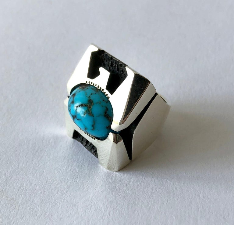 Faceted sterling silver Thunderbird ring with centered turquoise, created by Raymond Graves of Scottsdale, Arizona.  The Thunderbird is considered a spiritual, supernatural being of power and protection. Ring is heavy and large in scale an will fit