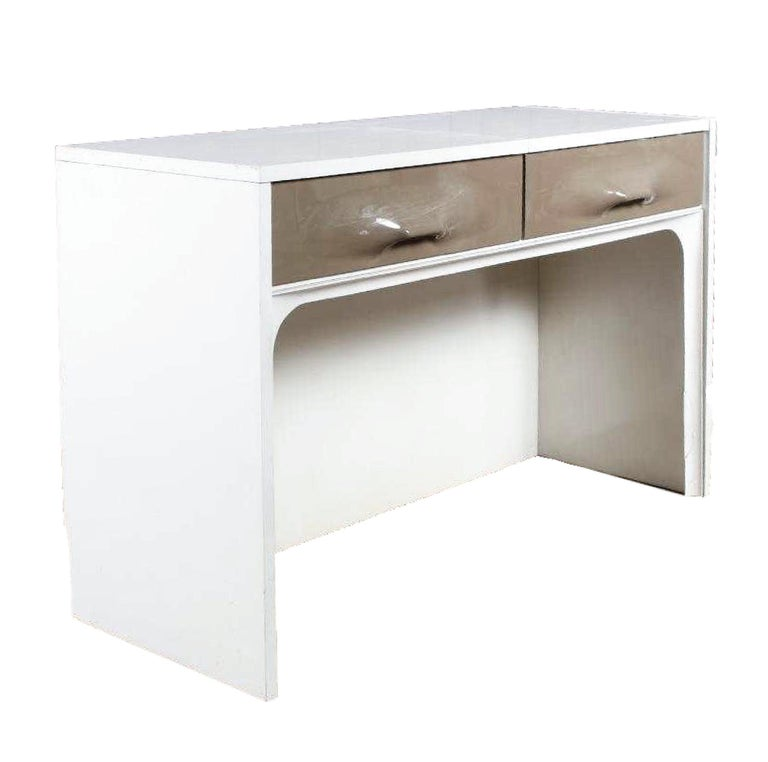 Lacquered wood (white) and French gray polycarbonate drawer fronts. One drawer front actually lifts to reveal a sizable mirror and additional surface / basin for storage. Toiletries at your fingertips, where you left them, mirror in tow, but hidden