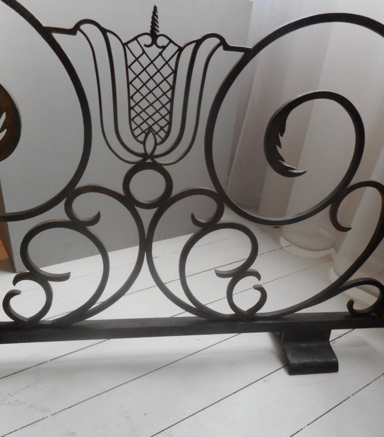 From the 1940s, resting on two-large feet, scrolls and leaves all in blackened iron. A similar firescreen can be seen in situ in a decoration by André Arbus ( see pictures) who probably designed this model in collaboration with Raymond Subes as